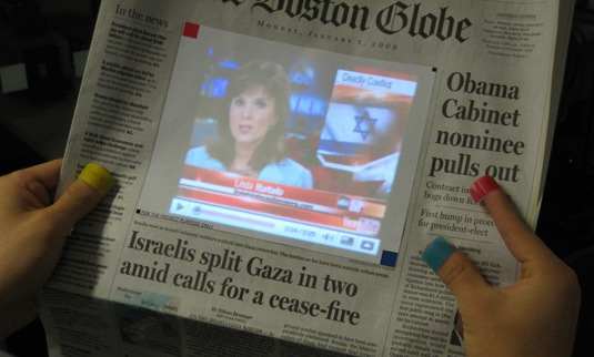 newspaper with live video