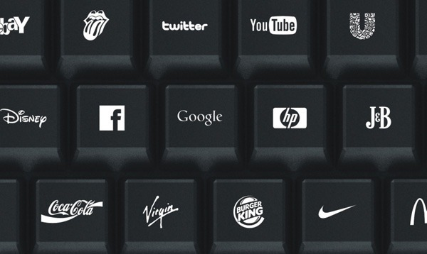 A Computer Keyboard With Logos Of Popular Brands